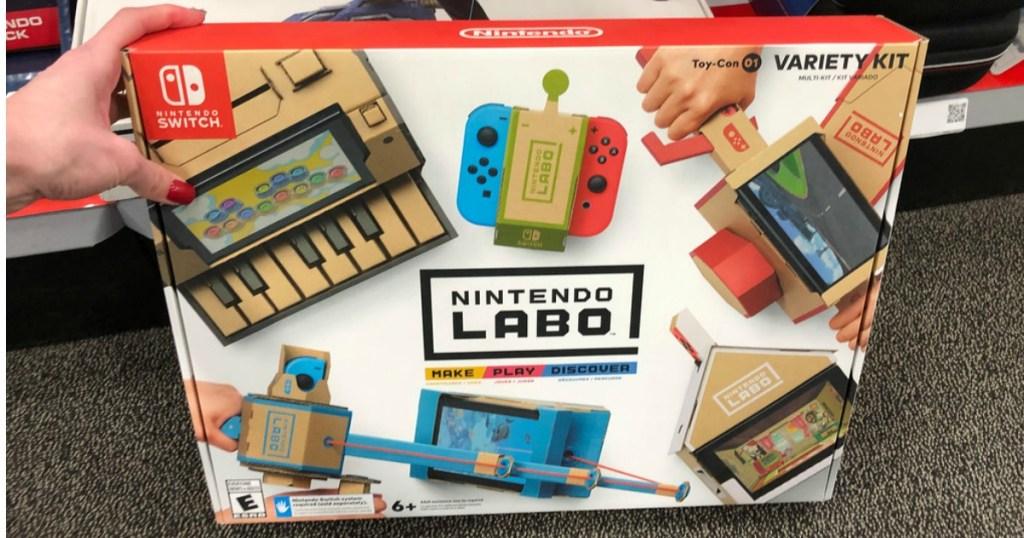 hand holding Nintendo LABO Variety Kit on floor