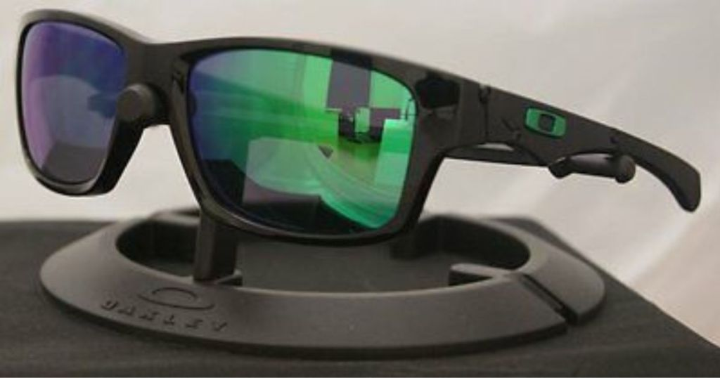 black sunglasses with green blue lenses