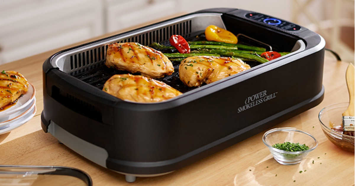 power smokeless grill with chicken breast and veggies cooking in grill