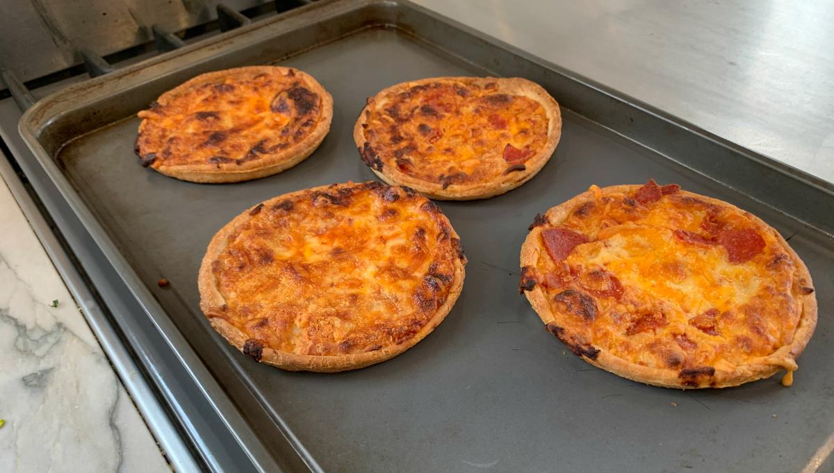 Sabatasso's frozen pizza singles baked on a pan
