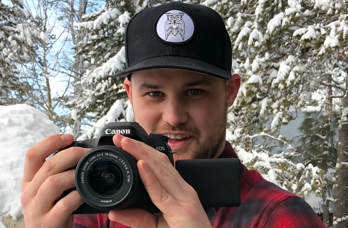 Stetson holding a digital camera