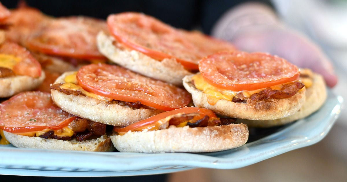 plate of bacon and tomato english muffins