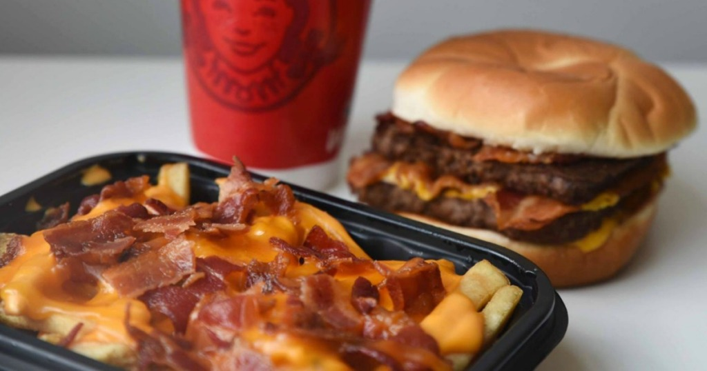 baconator fries with burger and drink in the background