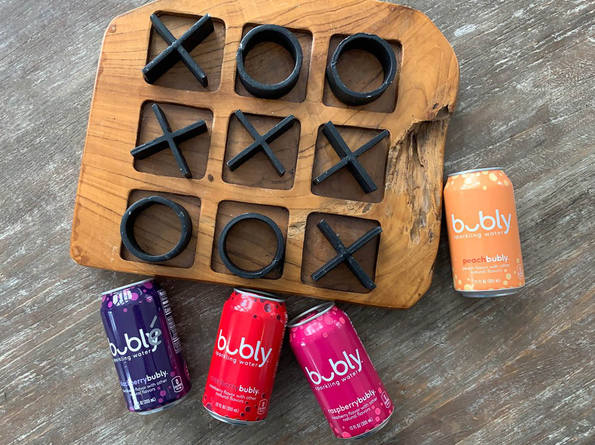 cans of Bubly near a tic tac toe board