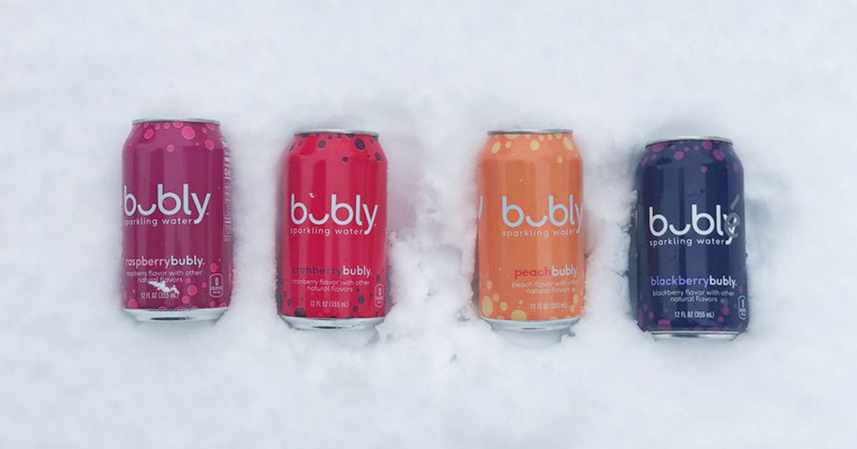 four cans of Bubly in the snow