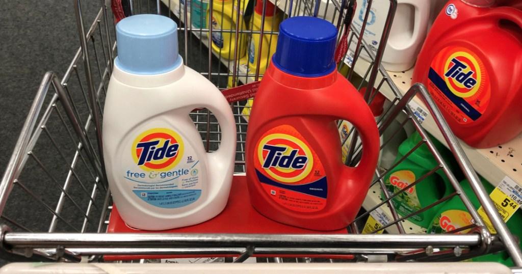 two bottles of Tide detergent in a CVS cart