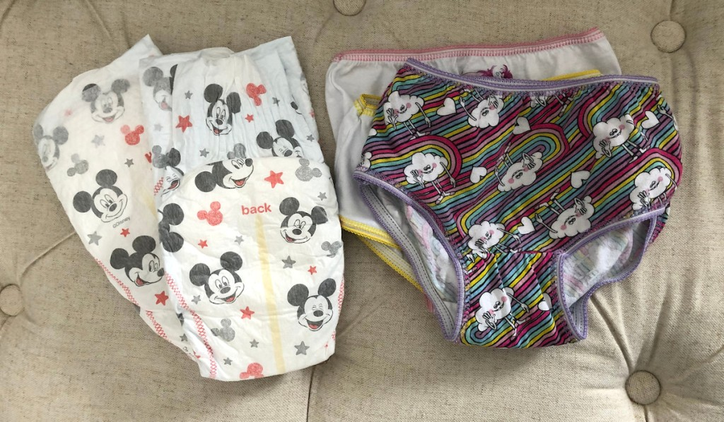 mickey mouse huggies diapers and trolls theme underwear undies still on beige tufted bench