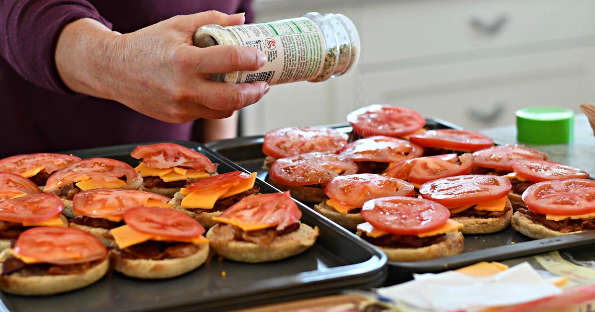 garlic salt seasoned tomato slice on top of english muffins