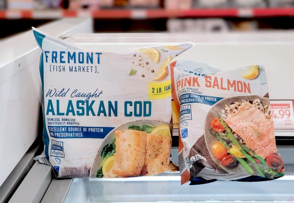 two bags of frozen cod and salmon