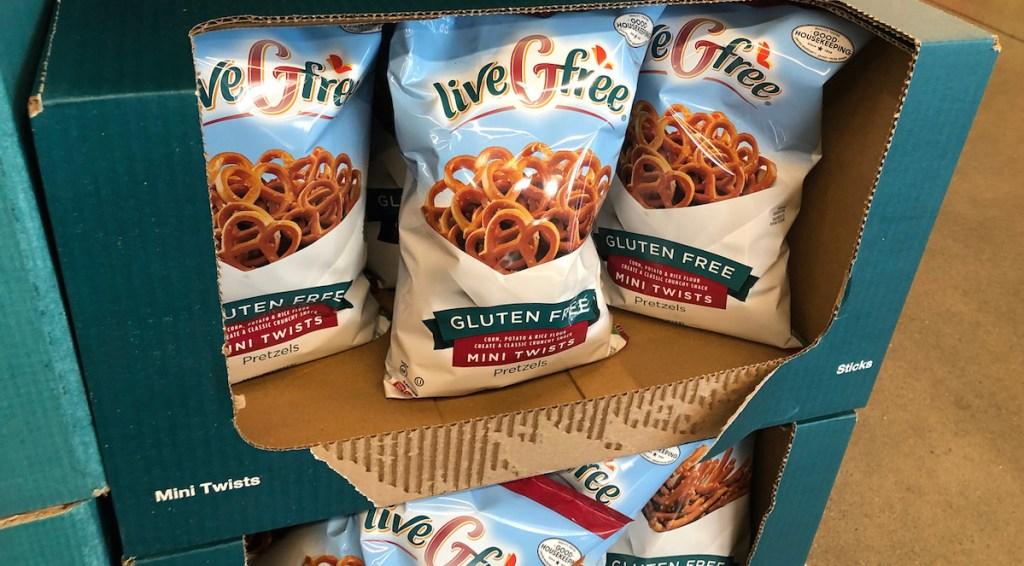 cardboard box full of bags of gluten free pretzels
