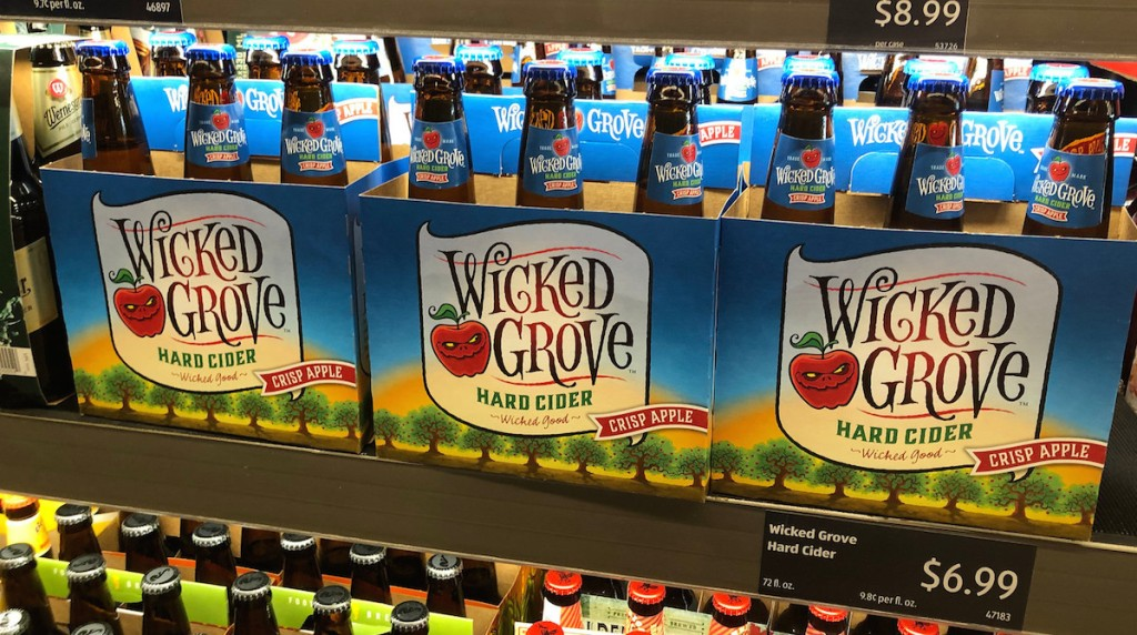 row of six packs wicked grove hard cider bottles alcoholic beverages