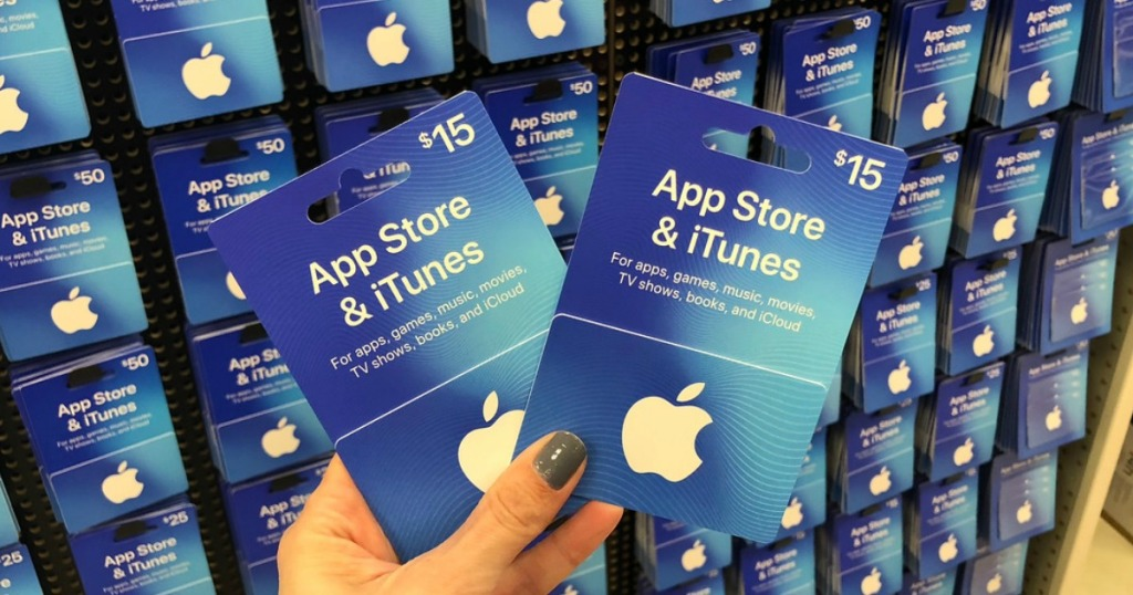 woman holding itunes gift cards