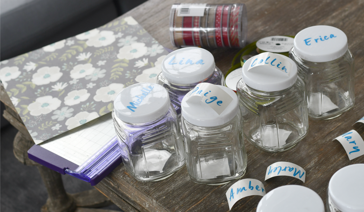 finished kindness jars on a table