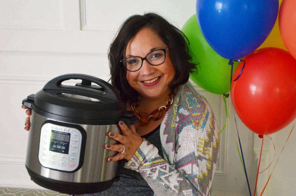 woman holding an instant pot by balloons