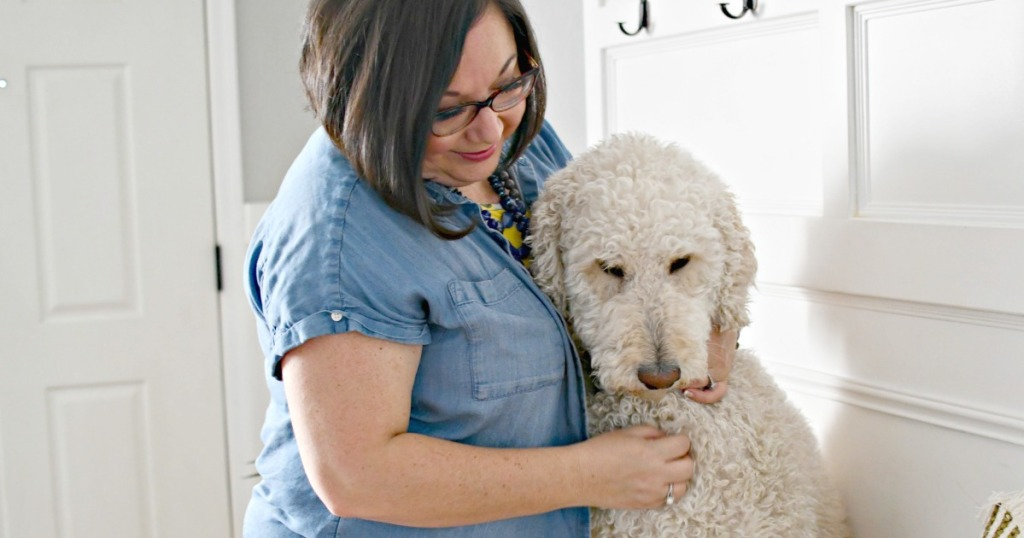 woman hugging a standard poodle