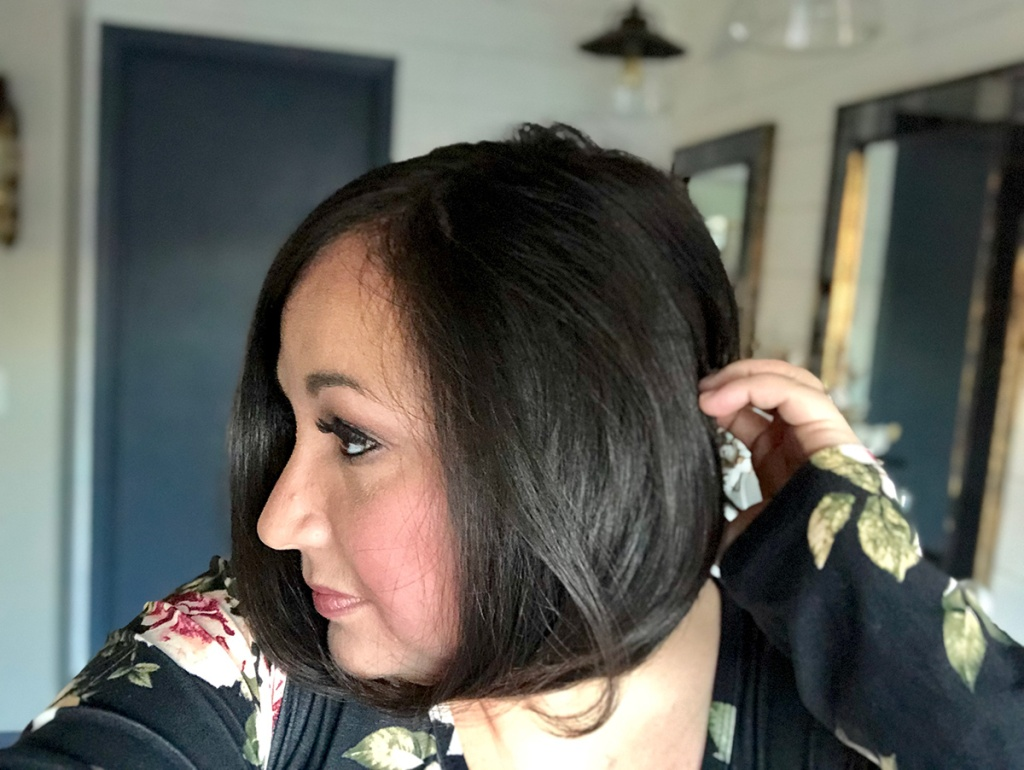woman showing side view of hair cut