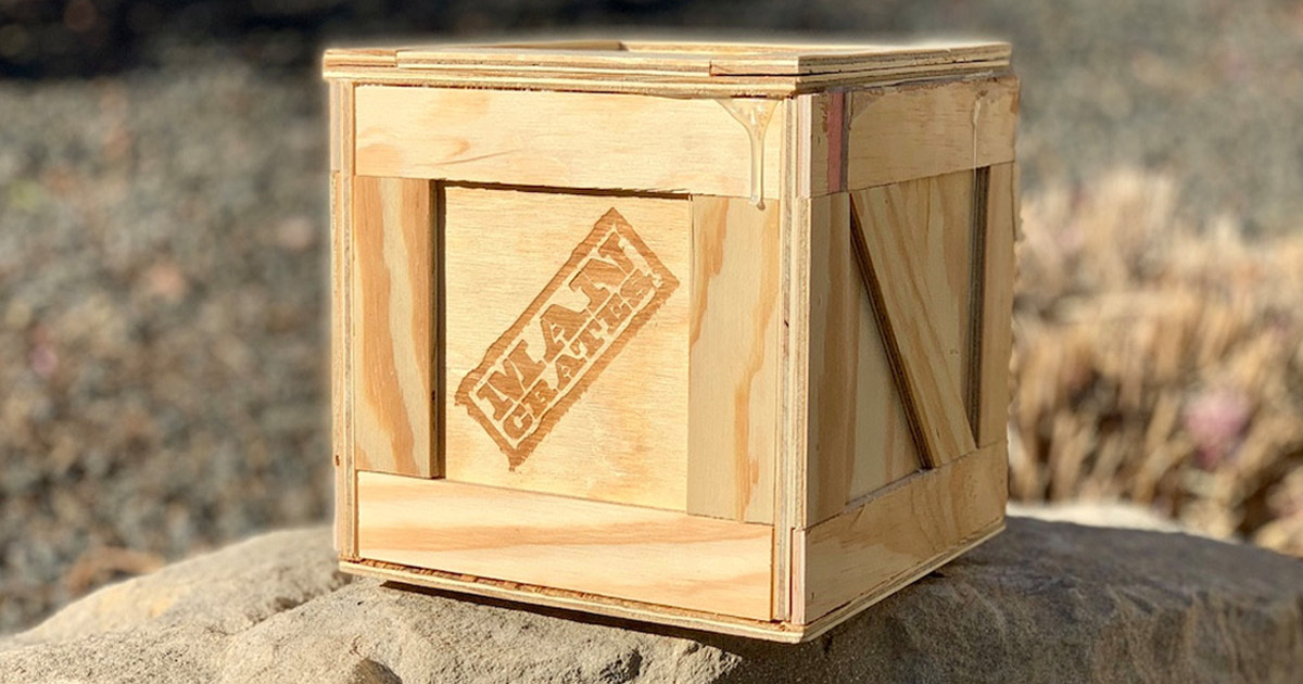 man crate on a rock
