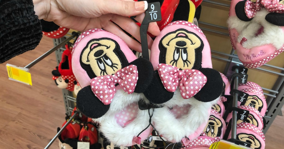 hand holding a pair of slippers