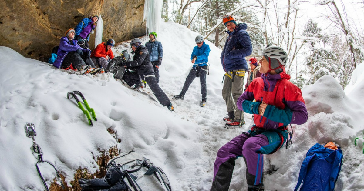 very cold scene of outdoor people in snow in a cave