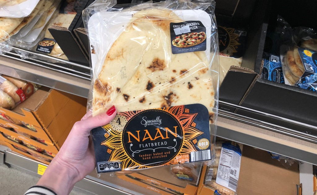 hand holding a package of naan bread