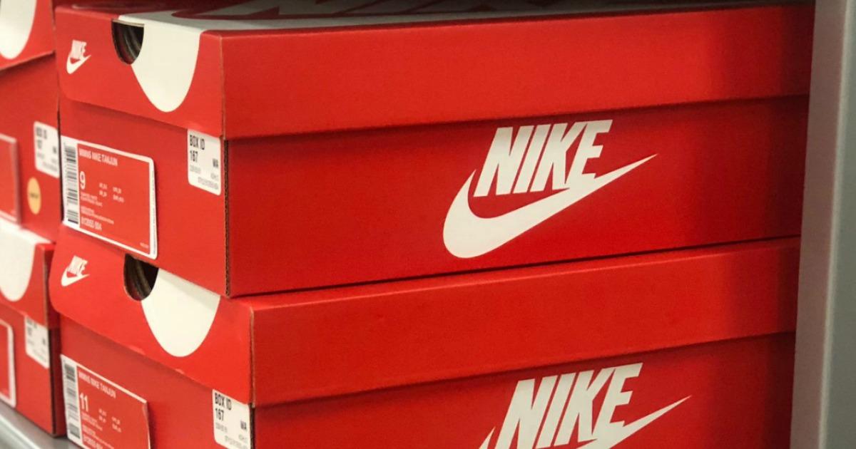 Orange Nike boxes stacked on shelf
