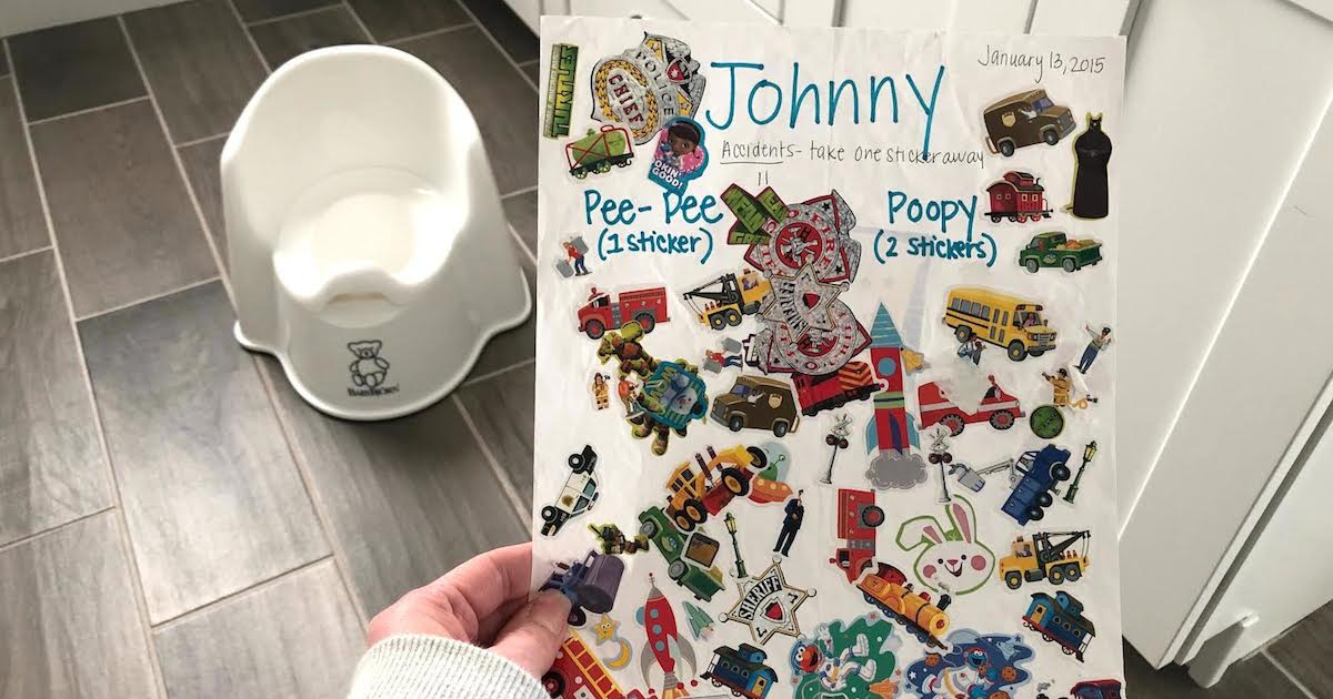white paper filled with stickers with training potty in the background on the floor