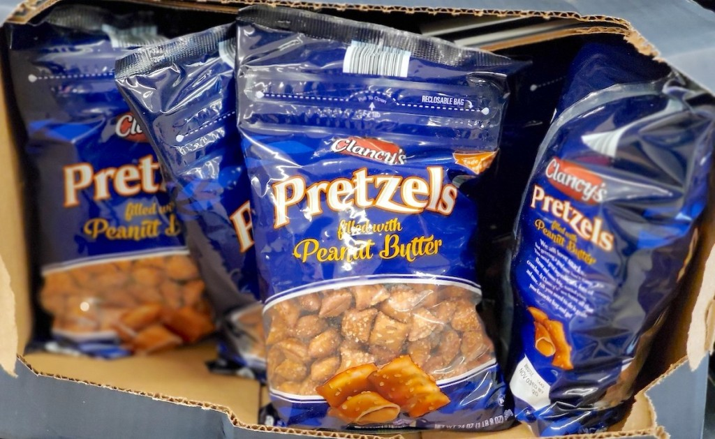 blue bags of peanut butter filled pretzels in cardboard box