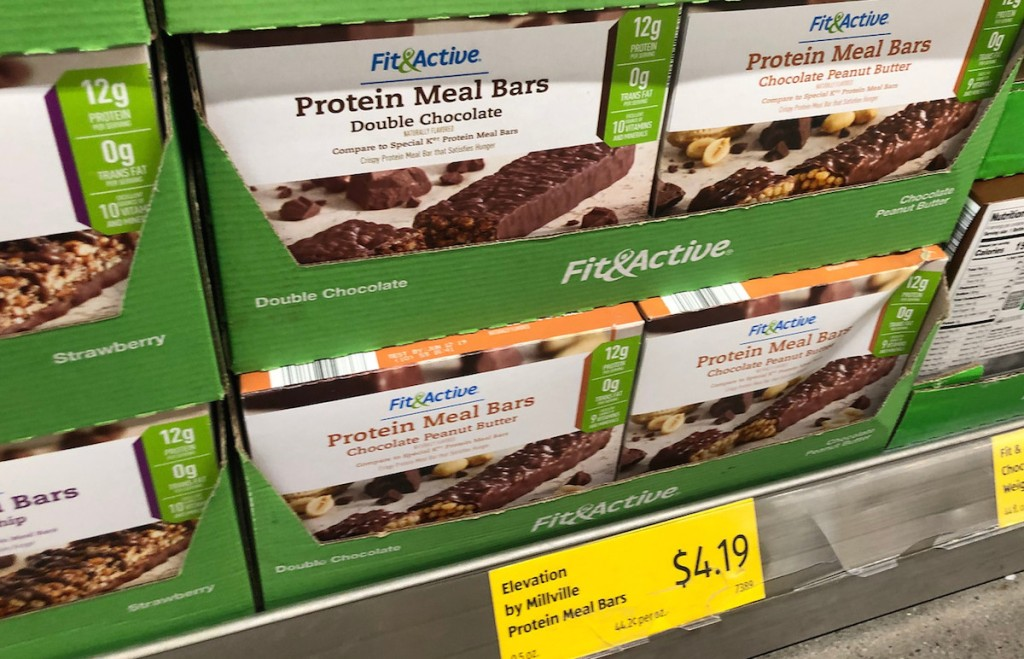 aisle of chocolate covered protein bars in boxes