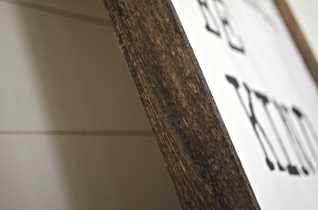 side of be kind wood sign