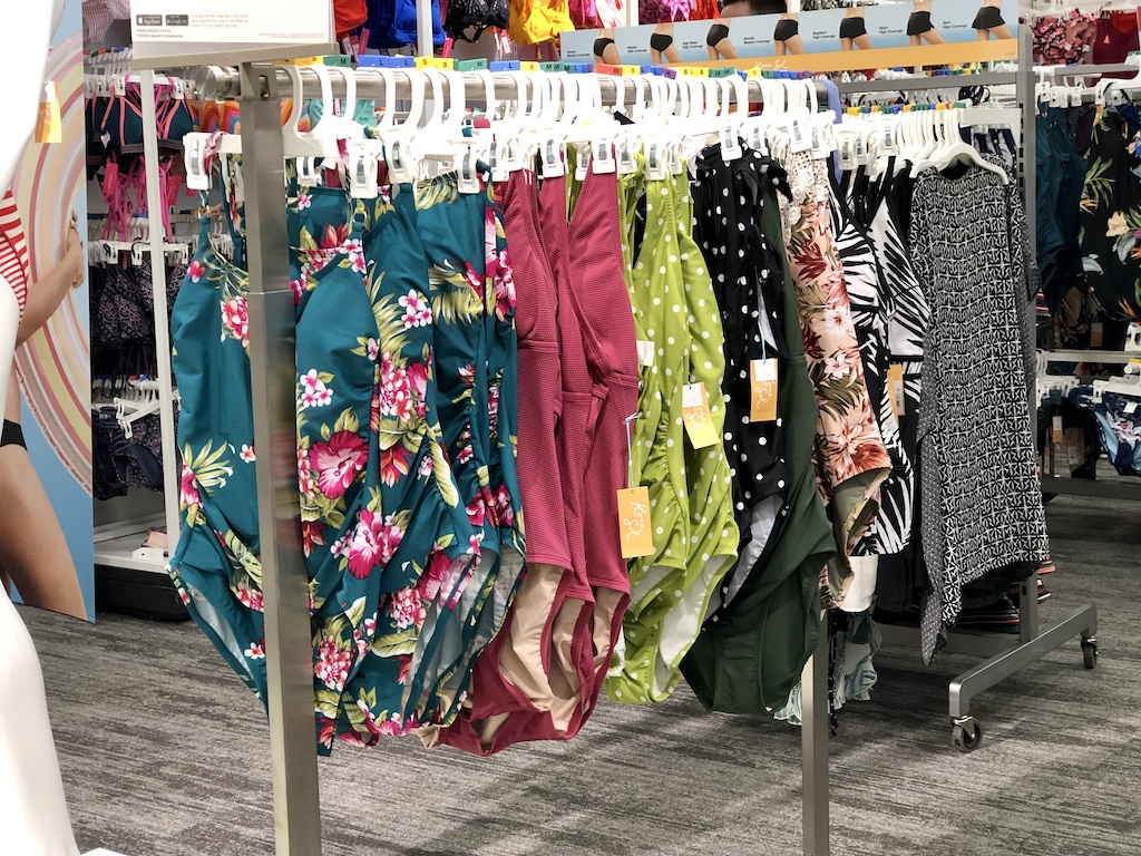 women's one-piece swimsuits on a clothing rack