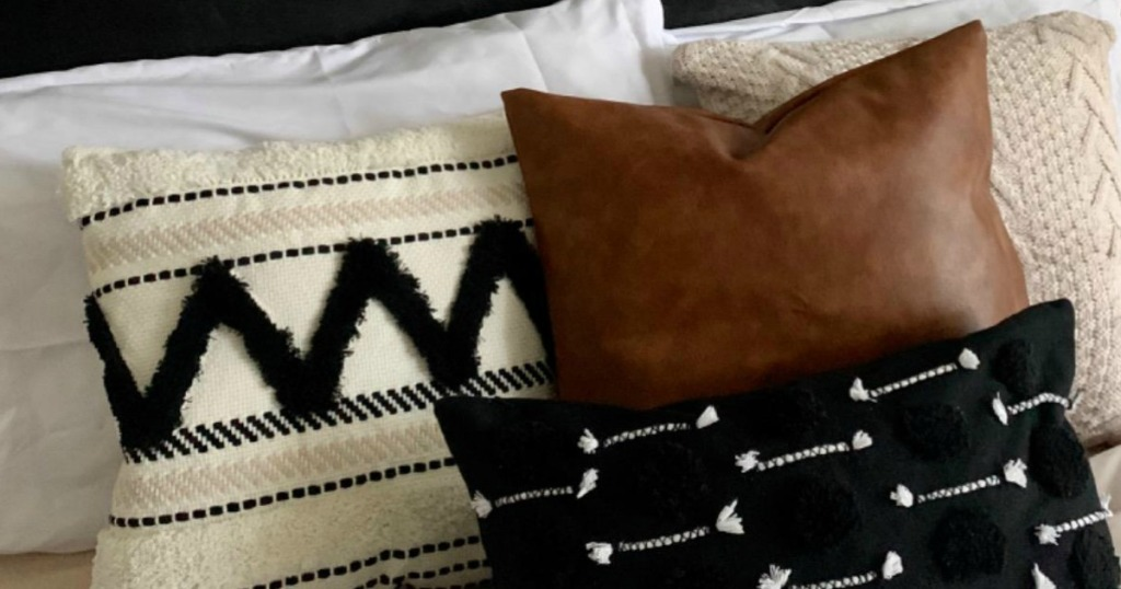 rustic throw pillows on bed