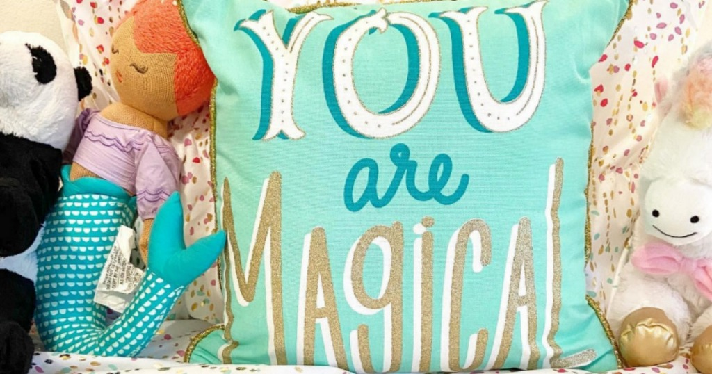 You are magical throw pillow on bed with other kids pillows