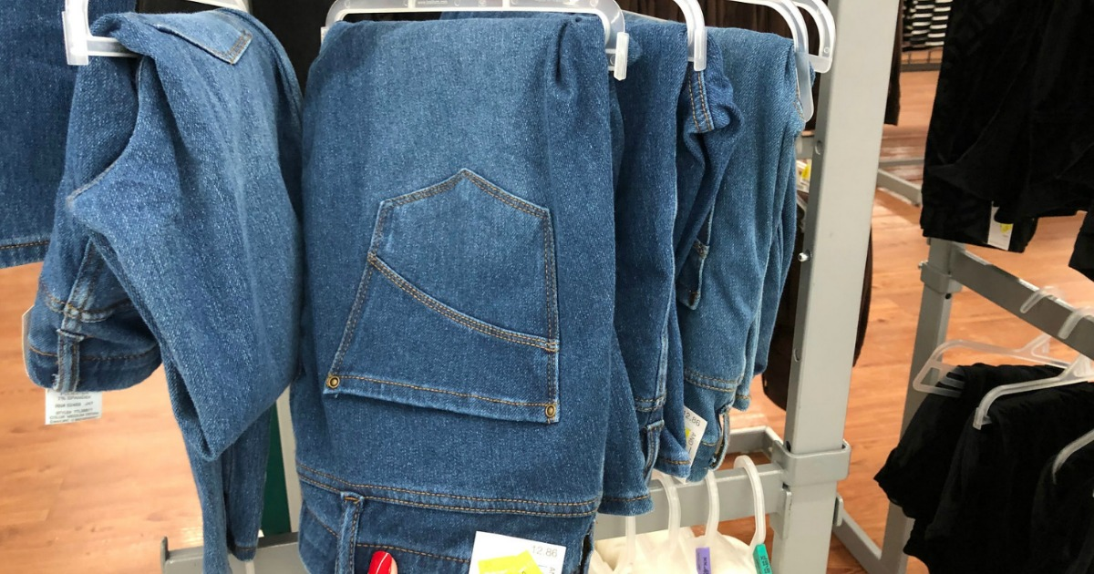 jeans hanging on clearance rack in store