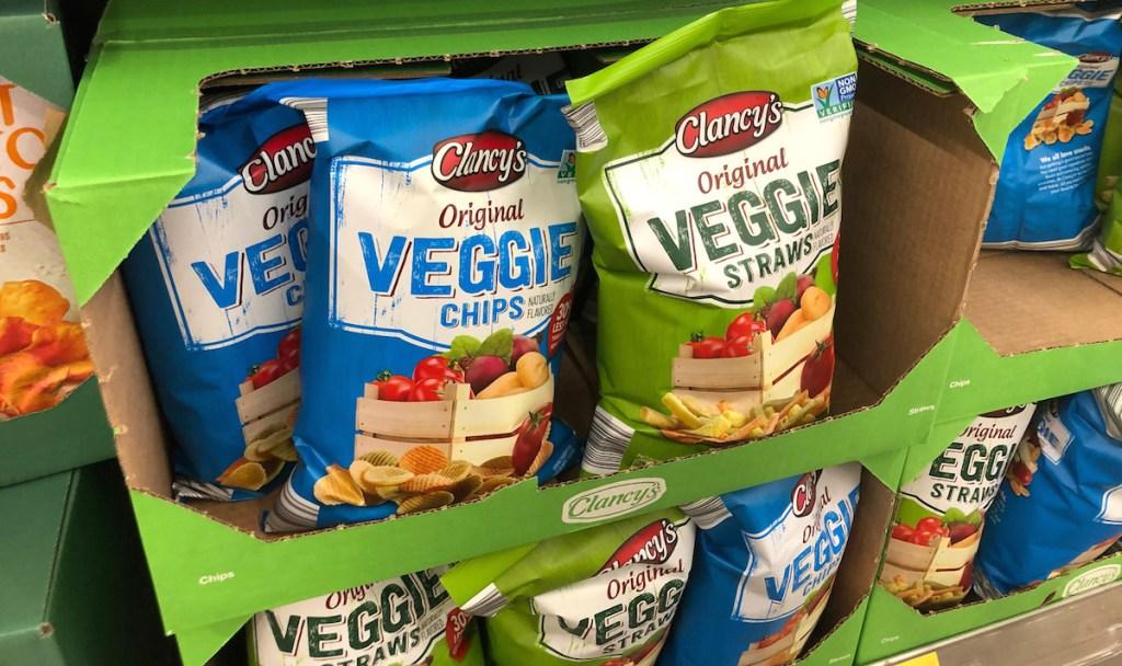 bags of veggie chips and veggie straws in green cardboard box