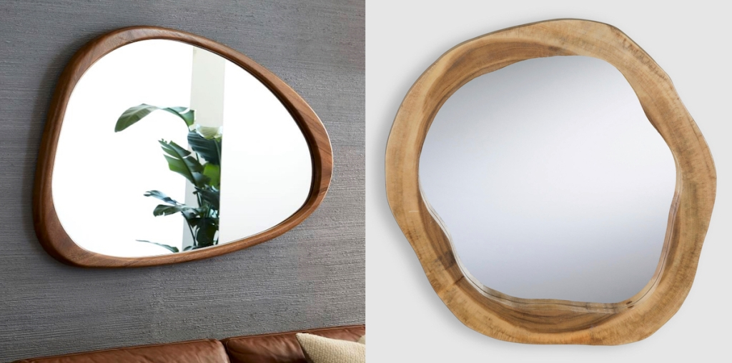 two wood framed mirrors hanging on walls