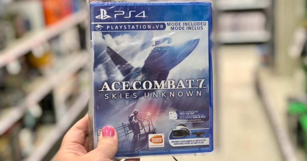 Hand holding Ace Combat 7 PS4 game