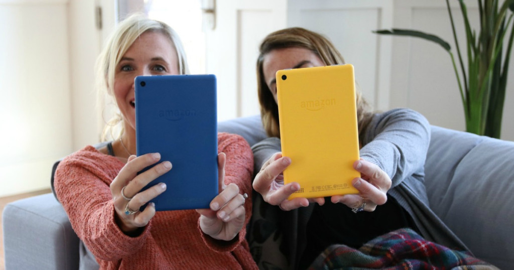 two women holding out kindles
