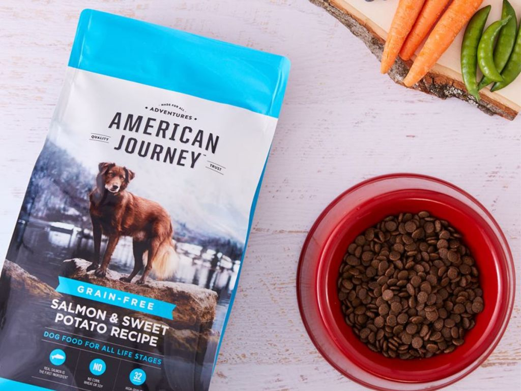 bag of American Journey dog food by a bowl