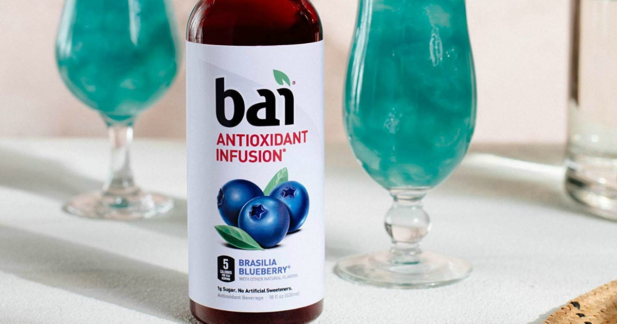 bottle of bai antioxidant infusion flavored water on a table with glasses filled with bai