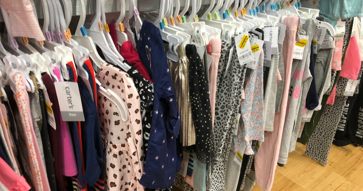girls clothes hanging on a store rack