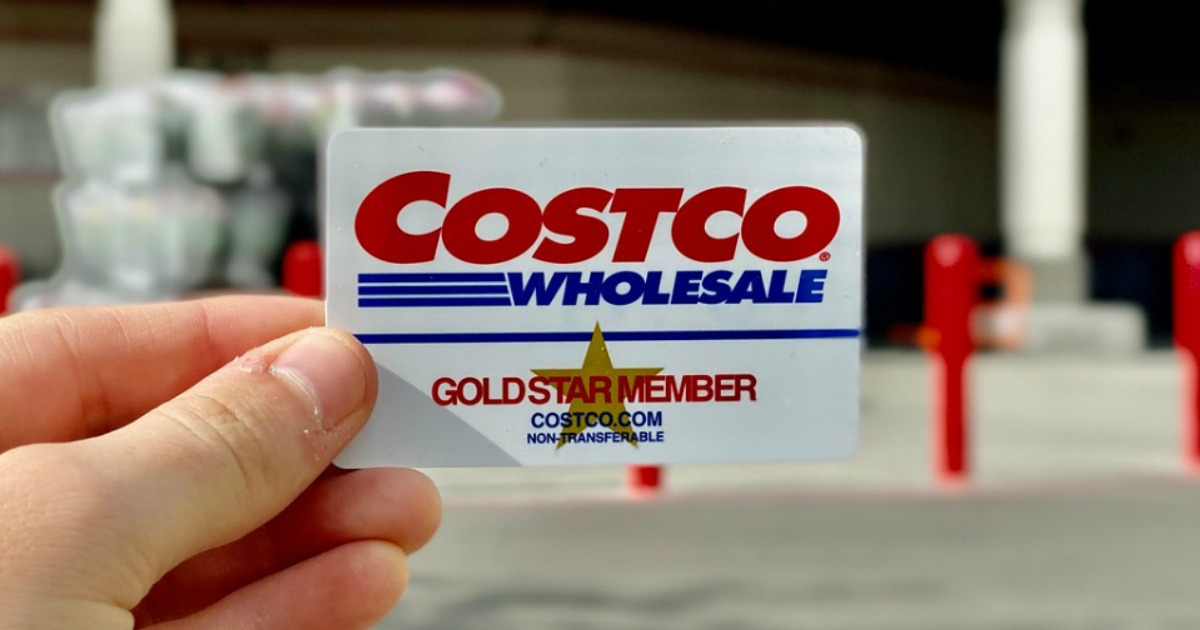 person holding up a costco card