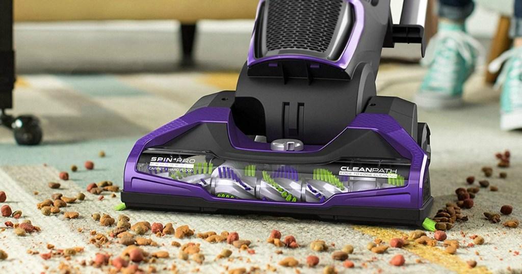 purple vacuum on carpet
