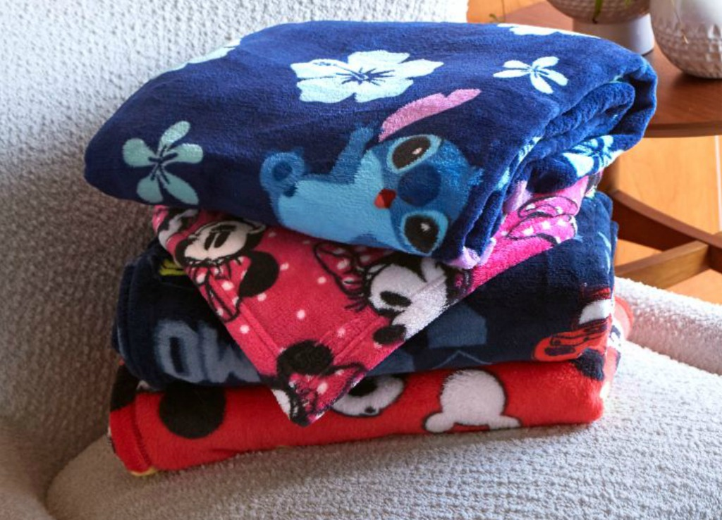 three throw blankets stacked on top of each other