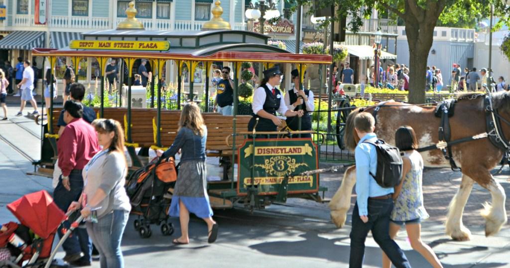 Disney park with people walking around