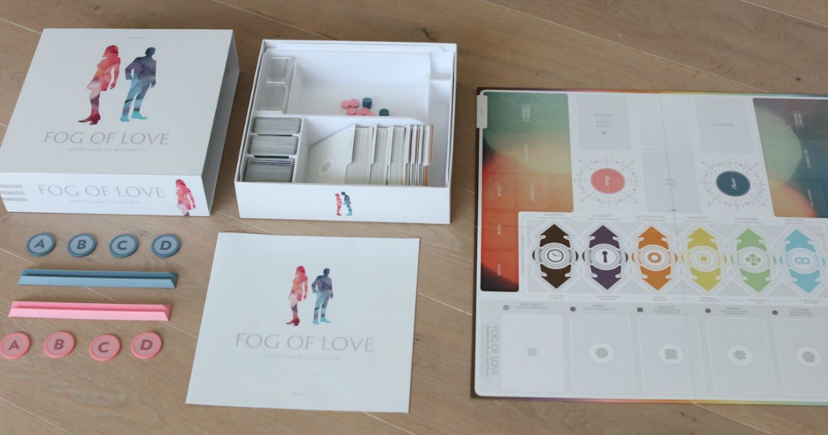 Fog of love board game with all contents out of the box and organized on table