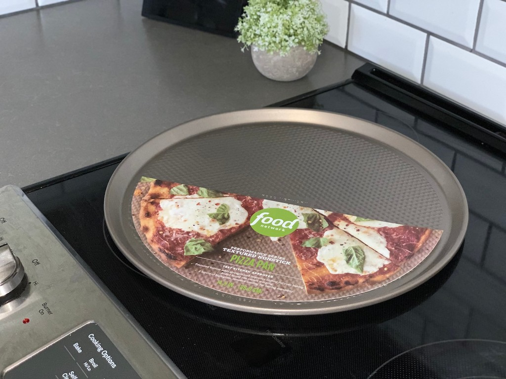 food network pizza pan on a glass stovetop