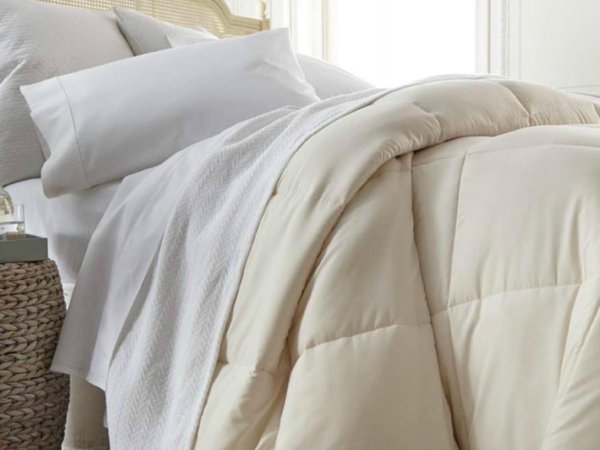 down alternative comforter on bed in cream