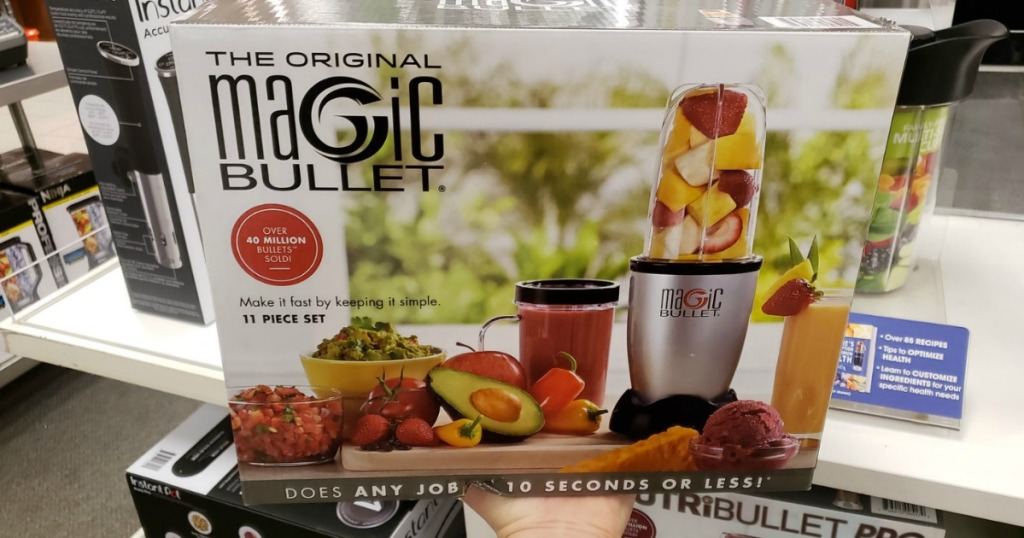 hand holding the Magic Bullet 11 piece box