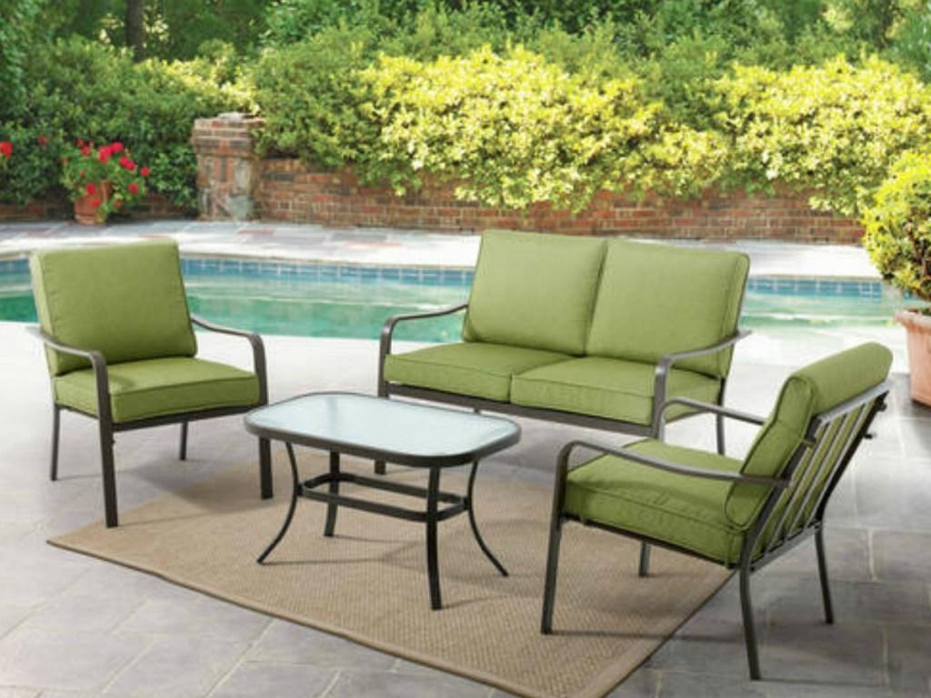 Mainstays Stanton Cushioned 4-Piece Patio Conversation Set next to pool