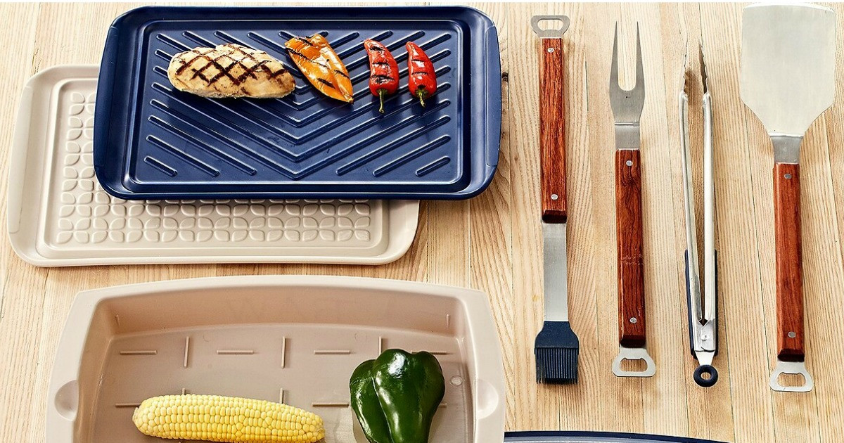 collection of grilling accessories laid out with chicken and veggies
